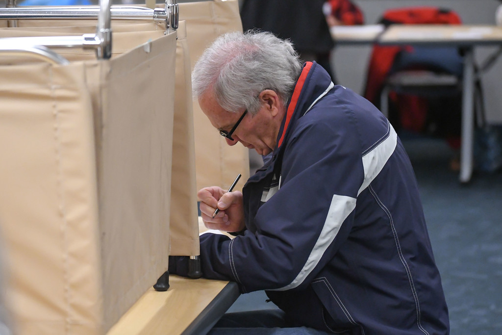 . Eric Bonzar�The Morning Journal<br> Charles Worcester, a 25-year resident of Vermilion, uses a pencil to cast his ballot at Ritter Public Library, Nov. 7, 2017.
