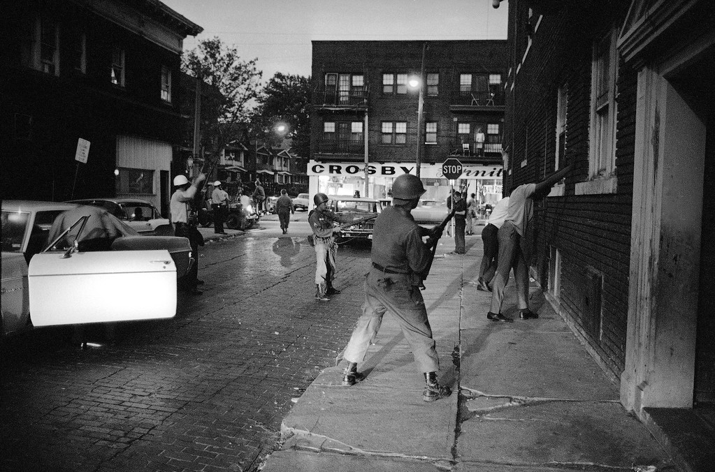 . National Guardsmen hold riot suspects for police search as the sixth night of possible violence and vandalism descends on riot-reeling Cleveland, July 23, 1966. (AP Photo)