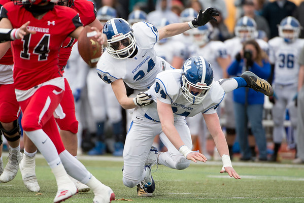 11/28/19 Wesley Bunnell | Staff Southington football vs Cheshire in the Apple Valley Classic on Thanksgiving morning at Cheshire High School. Angelo Plantamuro (34) gets tangled with Riley Clingan (94).