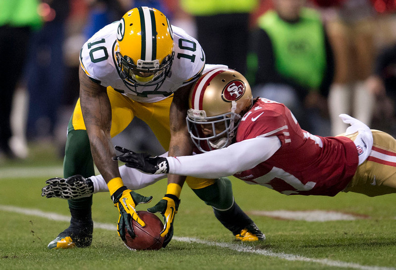 . Green Bay Packers wide receiver Jeremy Ross (10) muffs a punt return that is recovered by San Francisco 49ers defensive back C.J. Spillman (27) in the first half of an NFC divisional playoff NFL football game on Saturday, Jan. 12, 2013, in San Francisco. (AP Photo/The Sacramento Bee, Hector Amezcua)