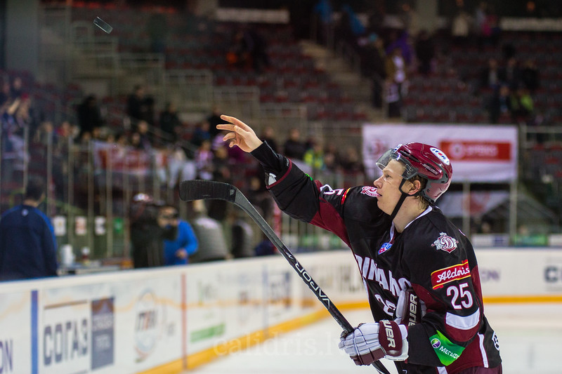 Andris Dzerins (25) after the game throws the puck to supporters