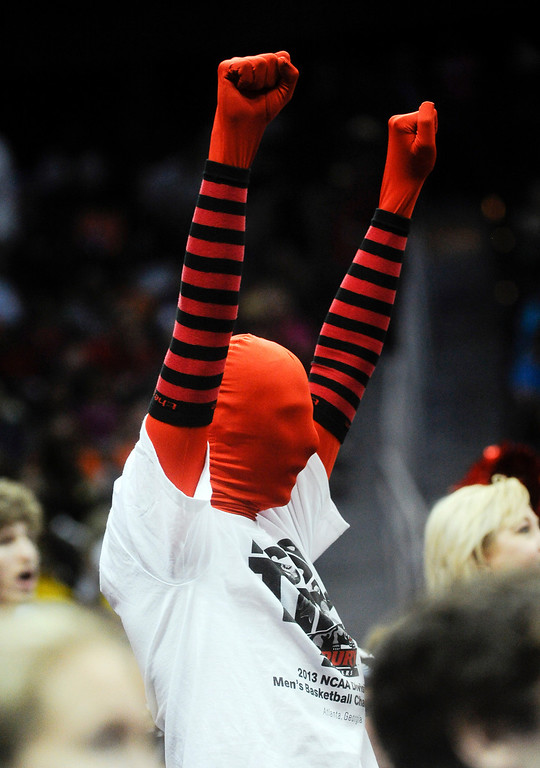 . A Drury fan cheers during the first half of the NCAA Division ll national championship college basketball game against Metro State, Sunday, April 7, 2013, in Atlanta. (AP Photo/John Amis)