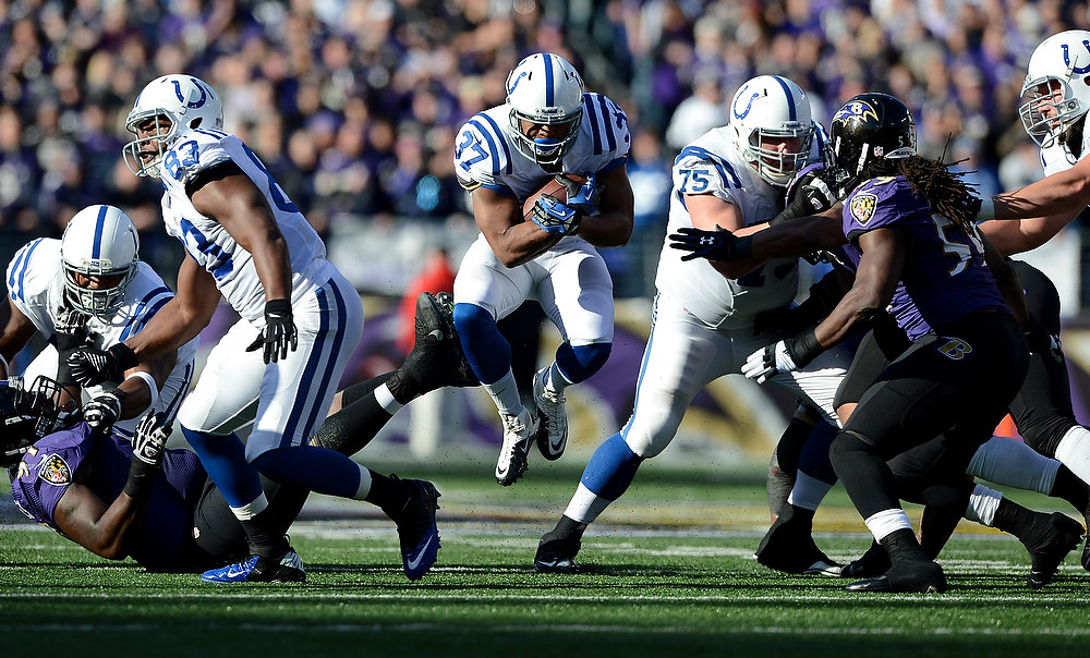 . Mewelde Moore #37 of the Indianapolis Colts runs the ball in the first half against the Baltimore Ravens during the AFC Wild Card Playoff Game at M&T Bank Stadium on January 6, 2013 in Baltimore, Maryland.  (Photo by Patrick Smith/Getty Images)
