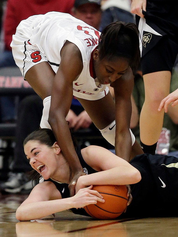 . Colorado \'s Meagan Malcolm-Peck (14), bottom, battles for a loose ball against Stanford\'s Chiney Ogwumike (13) during the first half of an NCAA college basketball game in Stanford, Calif., Sunday, Jan. 27, 2013. (AP Photo/Marcio Jose Sanchez)