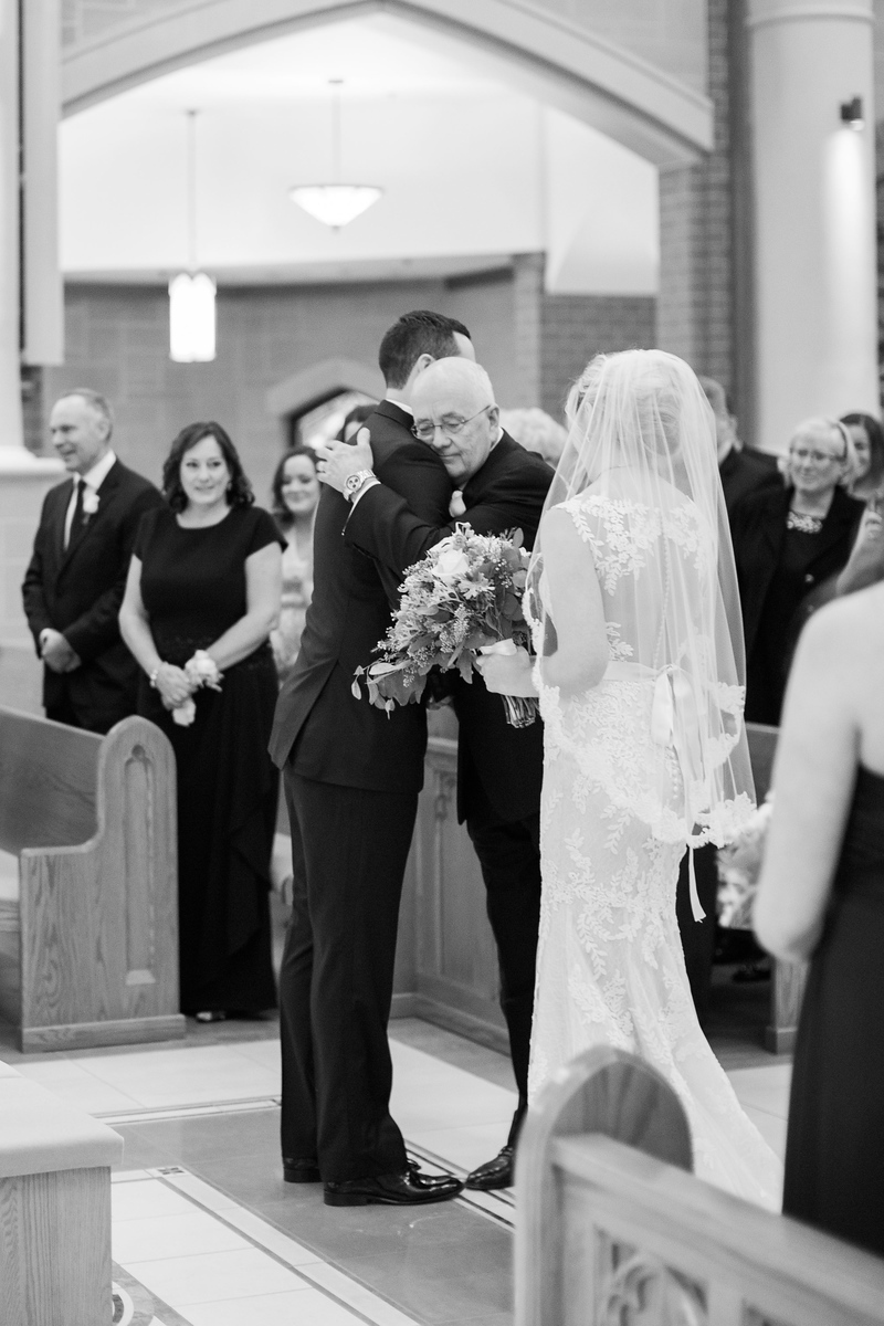 Father hands bride off to groom at their Bluemont Vineyard wedding. Photos by top Washington DC wedding photographer Jalapeno Photography. The Catholic wedding ceremony was at St. Theresa Catholic Church in Ashburn, VA.