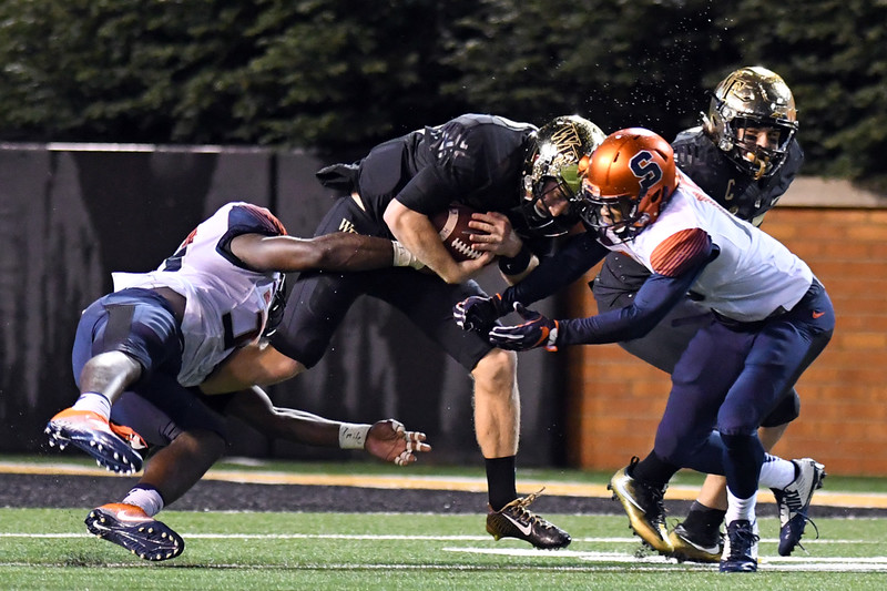 John Wolford tackled by P Bennett.jpg