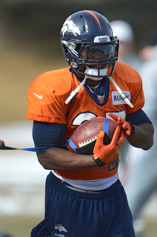 . Denver Broncos running back Knowshon Moreno (27) runs through drills during practice Wednesday, January 8, 2013 at Dove Valley.  John Leyba, The Denver Post