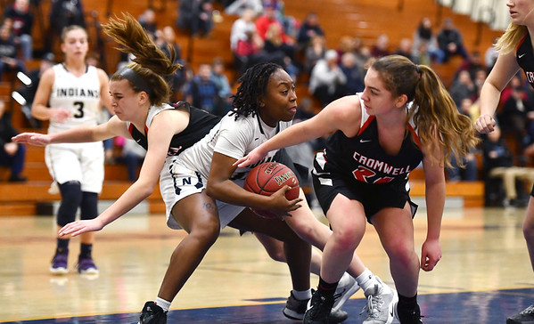 2/8/2020 Mike Orazzi | StaffrNewington's Ashanti Frazier (10) and Cromwell's Marykate Sullivan (34) on Saturday morning in Newington. r