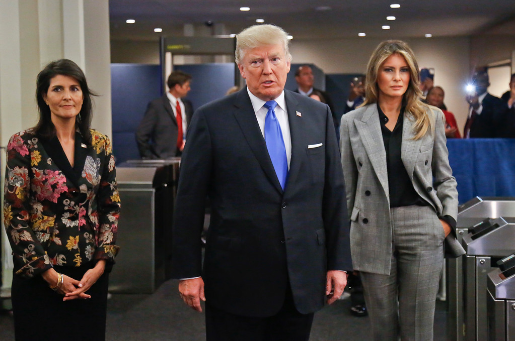 . President Donald Trump, center, arrives with first lady Melania Trump, right, and U.S. United Nations Ambassador Nikki Haley, left, for the meeting of the U.N. General Assembly, Tuesday Sept. 19, 2017 at U.N. headquarters. (AP Photo/Bebeto Matthews)