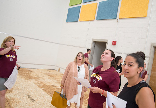 06/12/19 Wesley Bunnell | Staff Smalley School second grade teacher Robin Pizzuto, L, points out details of the new gymnasium to fellow teachers during a walk through by teachers and administrators on June 12, 2019. The walk through allowed teachers and administrators their first glimpse of the renovations and additions which are scheduled for completion in August.
