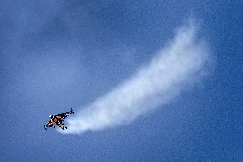 ". Swiss pilot Yves Rossy known as the ""Jetman\"" flies with his jet-powered 2 meters wingspan wing attached to his back during the first day of AIR14 air show on August 30, 2014 in Payerne, western Switzerland. The airshow commemorates over two week-ends the 100th anniversary of the Swiss Air Forces.  AFP PHOTO / FABRICE COFFRINI/AFP/Getty Images"