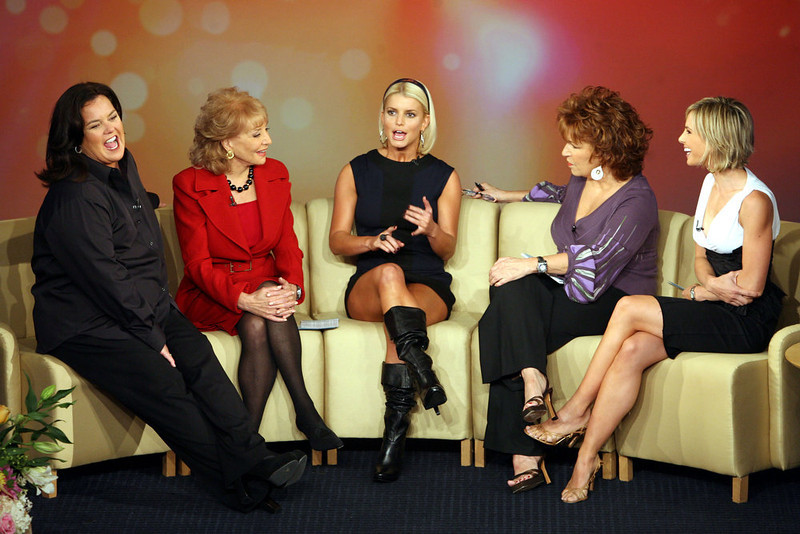 ". Singer Jessica Simpson, center, joins ""The View\"" co-hosts Rosie O\'Donnell, left, Barbara Walters, second from left,  Joy Behar, second from right, and Elisabeth Hasselbeck during the taping of the first show of  the 10th season of the ABC women\'s chat show Tuesday, Sept. 5, 2006 in New York. The show began its 10th season with O\'Donnell joining the returning  Behar,  Hasselbeck and  Walters.  (AP Photo/Mary Altaffer)"