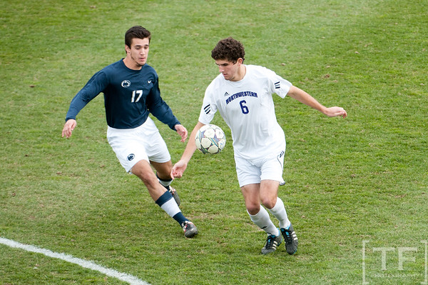Nov 13, 2011; Ann Arbor, MI, USA; Penn State Nittany Lions forward Julian Cardona (17) and Northwestern Wildcats midfielder Chris Ritter (6) battle for the ball in the first half at the final game of the 2011 Big Ten Championship at Michigan Soccer Stadium. Mandatory Credit: Tim Fuller-US PRESSWIRE
