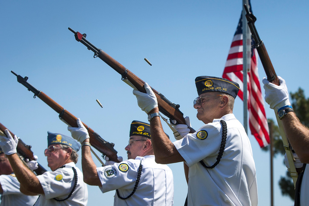 . Members of the honor and color guards fire a final volley at the conclusion of the Memorial Day service at the Mountain View Funeral Home and Cemetery in Mesa, Ariz.,  on Monday, May 26, 2014. The guards are members of the American Legion Post 27. Around 300 retired military members, their families and friends came to the observance to remember and honor the service people who sacrificed their lives for the protection and freedom of the country. (AP Photo/The Arizona Republic, Charlie Leight)