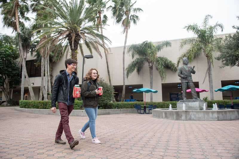 Students Gerardo Elena (left), and Lauren Graham make their way through the Hector P. Garcia Plaza on the first day of the Spring 2019 Semester.