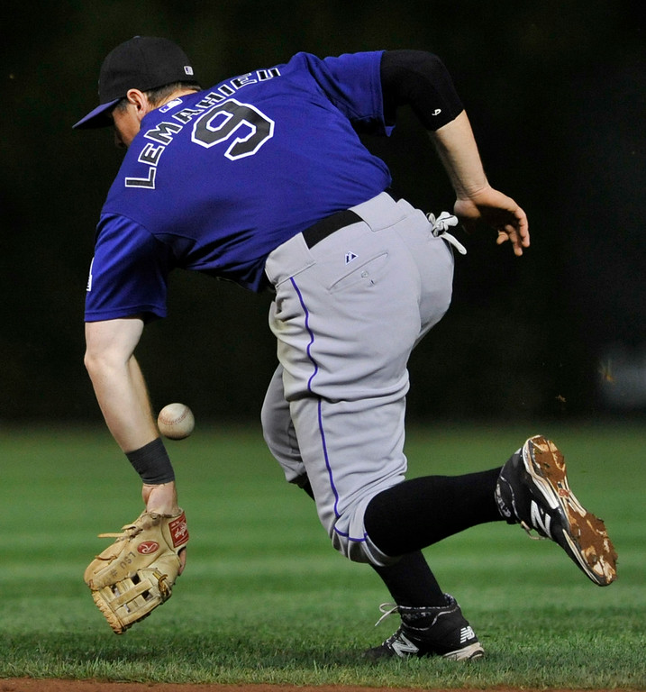 . Colorado Rockies second baseman D.J. LeMahieu misses a single hit by Chicago Cubs\' Ryan Sweeney during the fifth inning of a baseball game in Chicago, Wednesday, July 30, 2014. (AP Photo/Paul Beaty)