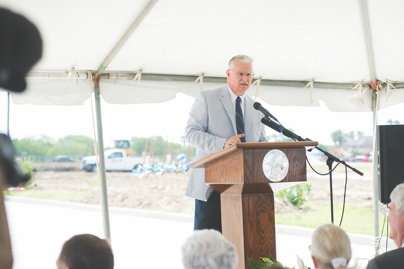 Don Albrecht welcomes guests to the Momentum Village phase 2 ground breaking ceremony.