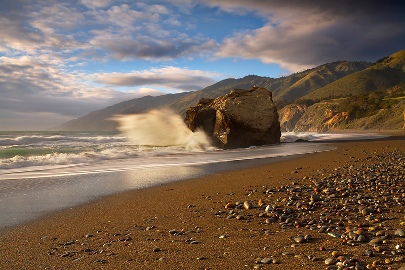 This 50 foot rock on San Carpoforo Beach at the south end of Big Sur really takes a beating at high tide. The 3,000-5,000 foot mountains make a nice backdrop when the light is right.  It took a considerable amount of running back and forth to get the proper perspective, as the water was moving fast.