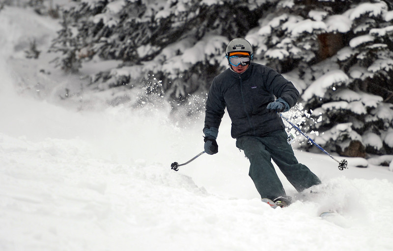 . A skier enjoys some fresh powder, Tuesday, December 18, 2012, at Loveland Ski Area.  Snow continues to fall though out much of the on the ski area.  RJ Sangosti, The Denver Post