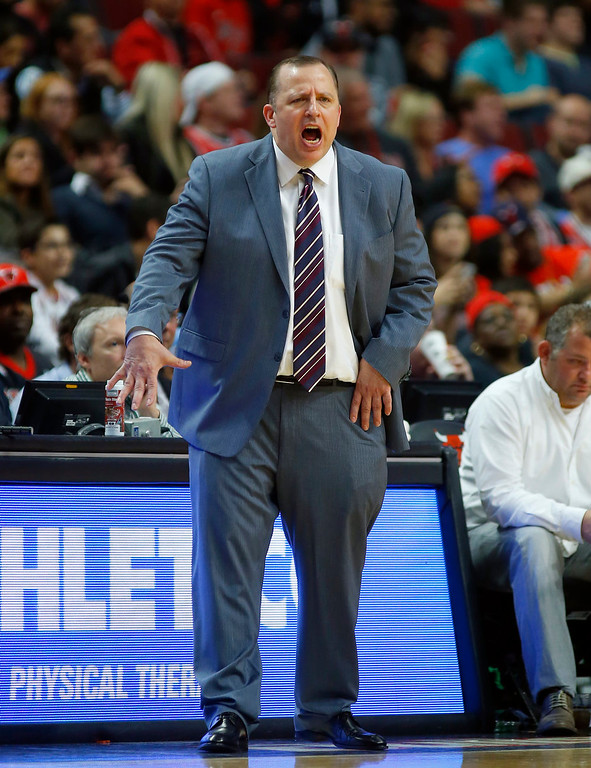 . Chicago Bulls head coach Tom Thibodeau yells at his team during the second half of a pre-season NBA basketball game in Chicago, on Monday Oct. 13, 2014. The Bulls won the game 110-90. (AP Photo/Jeff Haynes)