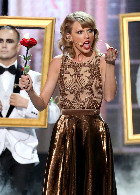 . Taylor Swift performs on stage at the 42nd annual American Music Awards at Nokia Theatre L.A. Live on Sunday, Nov. 23, 2014, in Los Angeles. (Photo by Matt SaylesInvision/AP)