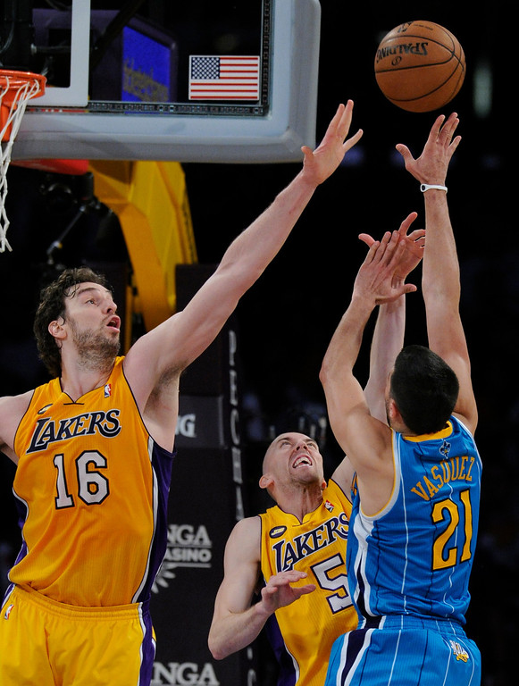 . Lakers#16 Pau Gasol and Lakers#5 Steve Blake go up to block a shot by Hornets#21 Greivis Vasquez in the 4th quarter. The Lakers defeated New Orleans Hornets 104-96 in a game played at Staples Center in Los Angeles, CA 4/9/2013(John McCoy/Staff Photographer
