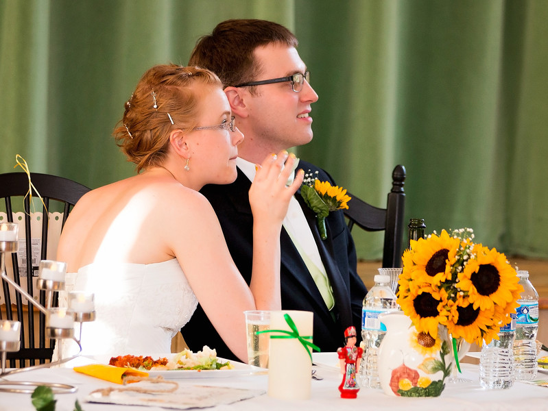 Bride and Groom at table listening to toasts.jpg