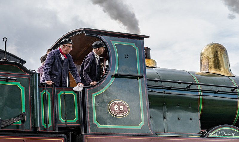 The crew of SER Stirling 0-6-0 No.65 as she passes
