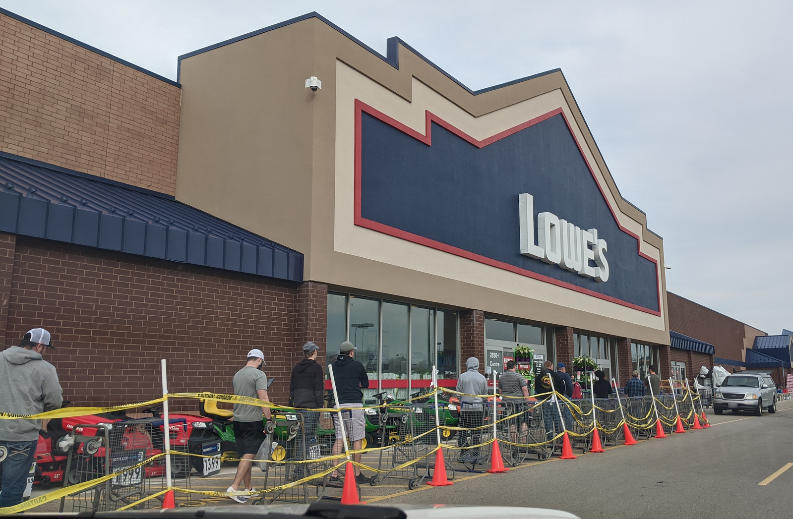 Customers waiting in line outside the Lowe's home improvement store in Beavercreek/Fairborn, Ohio, Apr. 11, 2020