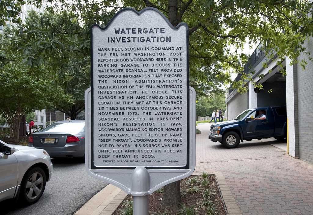 ". A historical marker on August 19, 2011 notes the parking garage in the Rosslyn neighborhood of Arlington, Virginia, where Washington Post reporter Bob Woodward met in secret with his source ""Deep Throat\"" (Senior FBI official Mark Felt) as Woodward investigated former US President Richard Nixon and the Watergate scandal in 1972 and 1973. The scandal ultimately lead to Nixon\'s resignation in 1974.     (SAUL LOEB/AFP/Getty Images)"