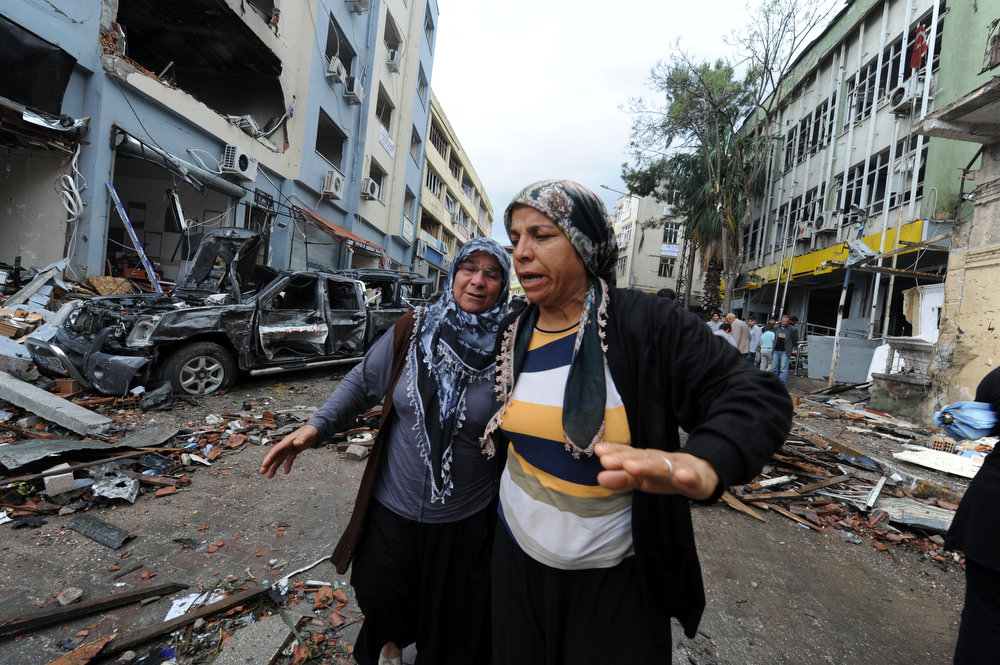 . Women cry as they search on May 12, 2013 for their relatives in the debris on a street damaged by a car bomb explosion which went off on May 11 in Reyhanli in Hatay, just a few kilometers from the main border crossing into Syria. Turkey was reeling from twin car bomb attacks which left at least 43 people dead in a town near the Syrian border, with Ankara blaming pro-Damascus groups and vowing to bring the perpetrators to justice. BULENT KILIC/AFP/Getty Images