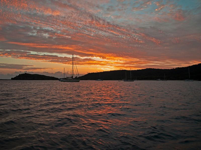 Orange stratocumulus cloudy island Sunrise Seascape. Australia