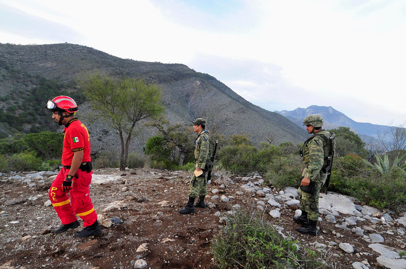 . A Civil Protection personnel and soldiers gather to inspect the perimeter of the crash site of a plane with Mexican-American singer Jenni Rivera on board, in the municipality of Iturbide, south of Monterrey December 9, 2012. Rivera died in a plane crash after the small jet she was travelling in went down in northern Mexico, her father said on Sunday. Speaking after the wreckage was discovered, the singer\'s father, Pedro Rivera, told Telemundo television all seven of the people on board the plane, including two pilots, had died. REUTERS/Stringer