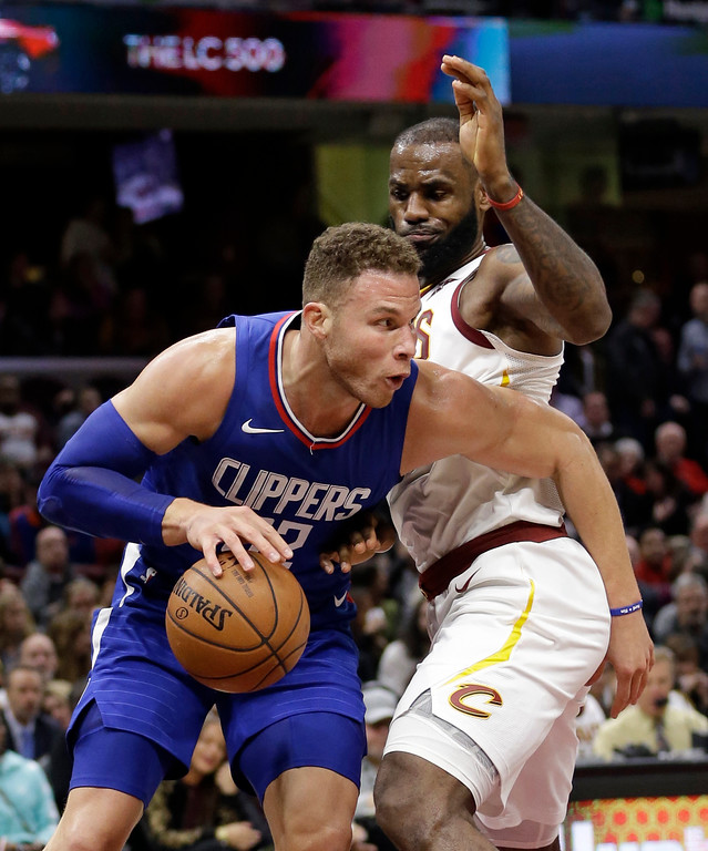 . Los Angeles Clippers\' Blake Griffin, left, drives against Cleveland Cavaliers\' LeBron James during the second half of an NBA basketball game, Friday, Nov. 17, 2017, in Cleveland. The Cavaliers won 118-113 in overtime. (AP Photo/Tony Dejak)