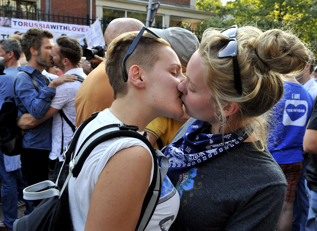 ". A lesbian couple kisses as they participate in a  \'Kiss-In\' action at the Russian consulate in Antwerp to protest against the treatment of lesbian, gay, bisexual and transgender oriented people in Russia on August 9, 2013.  Russia on Friday said it was unperturbed by threats of an Olympic boycott over a controversial law banning ""homosexual propaganda\"", despite wide-ranging criticism of the legislation from athletes to US President Barack Obama. GEORGES GOBET/AFP/Getty Images"