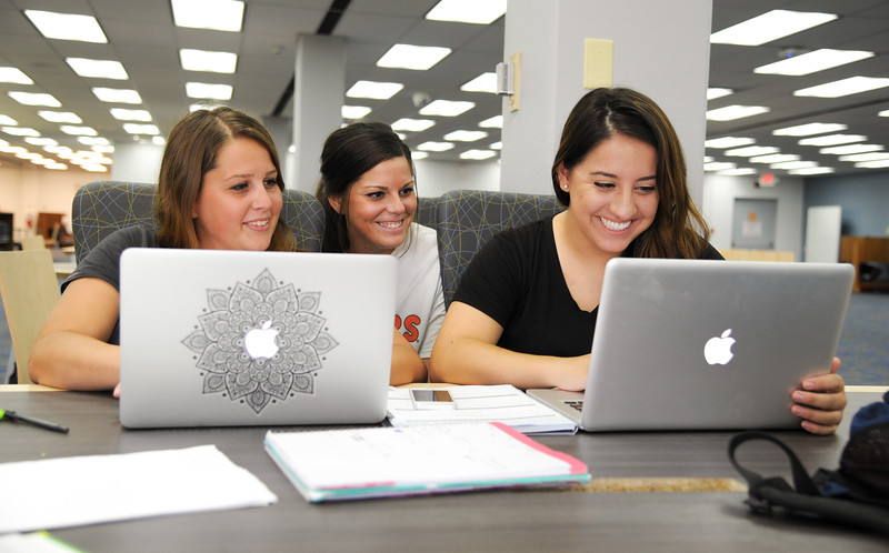 Students Sarah Reidy(left) , Cayla Horton, and Edy Lopez spend time in the library studying pediatric nursing.