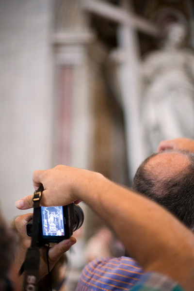Visitor taking a picture of Saint Helen statue, Saint Peter's basilica, Vatican
