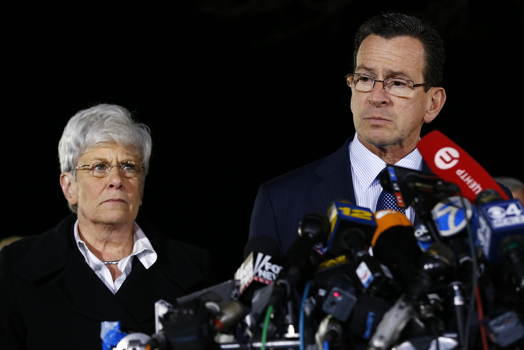 . Connecticut Gov. Dan Malloy and Lt. Gov. Nancy Wyman brief the media on the elementary school shootings during a press conference at Treadwell Memorial Park on December 14, 2012 in Newtown, Connecticut. Twenty-seven are dead, including 20 children, after a gunman identified as Adam Lanza in news reports, opened fire in Sandy Hook Elementary School in Newton. Lanza also reportedly died at the scene.  (Photo by Jared Wickerham/Getty Images)