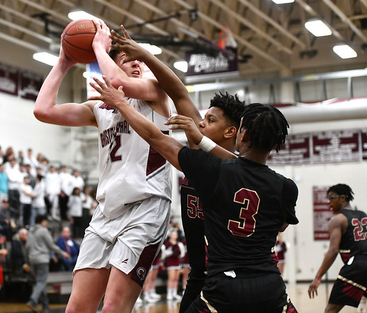 2/27/2020 Mike Orazzi | StaffrBristol Central High School's Donovan Clingan (32) during Thursday night's CCC boys basketball game with New Britain in Bristol. r