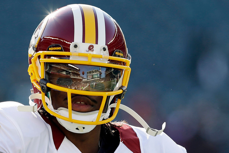 . Washington Redskins quarterback Robert Griffin III warms up before an NFL football game against the Philadelphia Eagles, Sunday, Dec. 23, 2012, in Philadelphia. (AP Photo/Mel Evans)