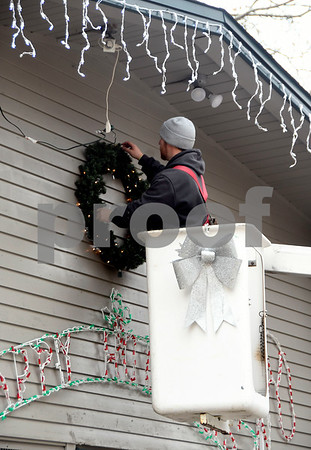11/30/2017 Mike Orazzi | Staff Bristol Parks & Recreation Department's Todd Anderson hangs a wreath at the Mrs. Rockwell's Playground Thursday afternoon.