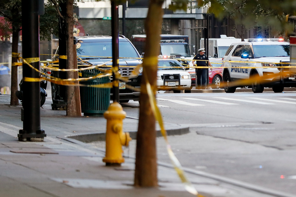 . An area is cordoned off with police tape as emergency personnel and police respond to reports of an active shooter situation near Fountain Square, Thursday, Sept. 6, 2018, in downtown Cincinnati. (AP Photo/John Minchillo)
