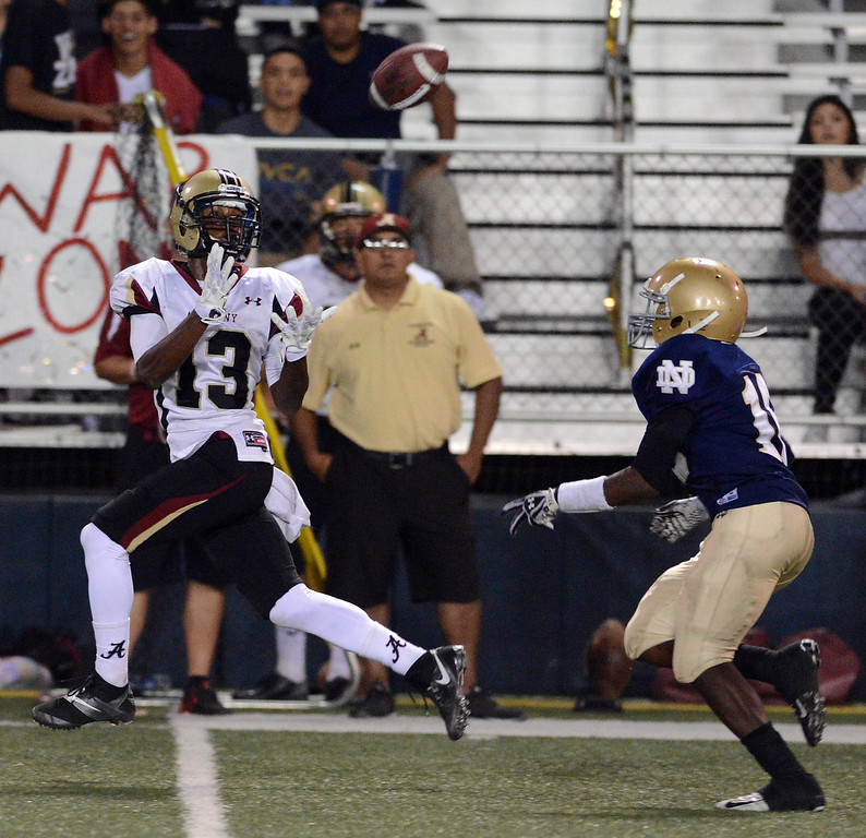 . Alemany\'s Desean Holmes #13 hauls in a long pass as Notre Dame\'s Christian Pikes #16 defends during their football game at Notre Dame High School Friday, October 18, 2013.  (Photo by Hans Gutknecht/Los Angeles Daily News)