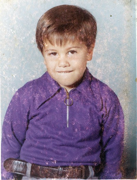 This is a school picture from kindergarten when I was 6 years old.
