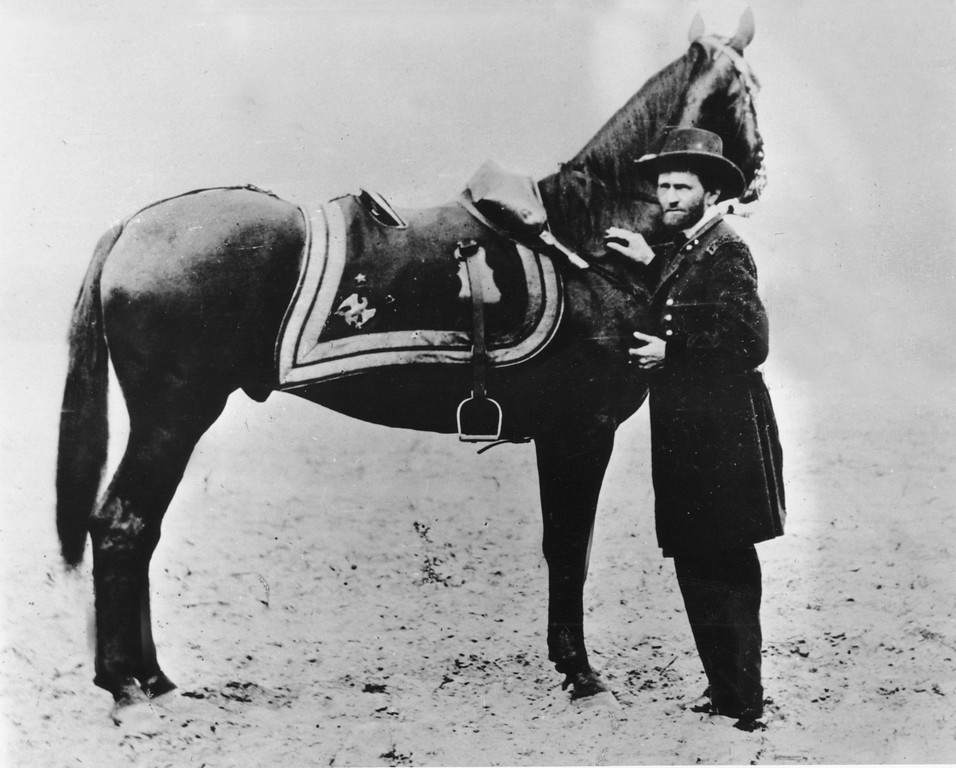. Gen. Ulysses S. Grant, commander of the Union Army during the American Civil War, poses with his horse in this undated photo at an unknown location.  (AP Photo)