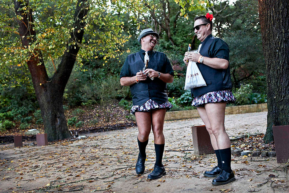 Description of . Danny Tatosian (L) and Robert Colman take a break as they attend a charity fashion show entitled Project Nunway given by The Sisters of Perpetual Indulgence in San Francisco, December 2, 2012.  The Sisters of Perpetual Indulgence (SPI) is a charity and street performance organization founded in 1979 which uses religious imagery to raise money for AIDS, LGBT-related causes, and mainstream community service organizations.  REUTERS/Jana Asenbrennerova