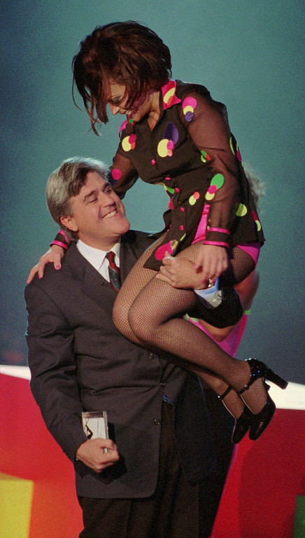 . Tonight Show host Jay Leno holds entertainer Paula Abdul up after her performance during the last day of taping the show in Las Vegas at the MGM Grand Hotel Friday, Nov. 17,1995. (AP Photo/Jack Dempsey)