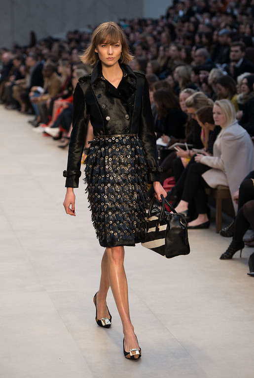 . Karlie Kloss walks the runway during the Burberry Prorsum show during London Fashion Week Fall/Winter 2013/14 at Kensington Gardens on February 18, 2013 in London, England. (Photo by Ian Gavan/Getty Images)