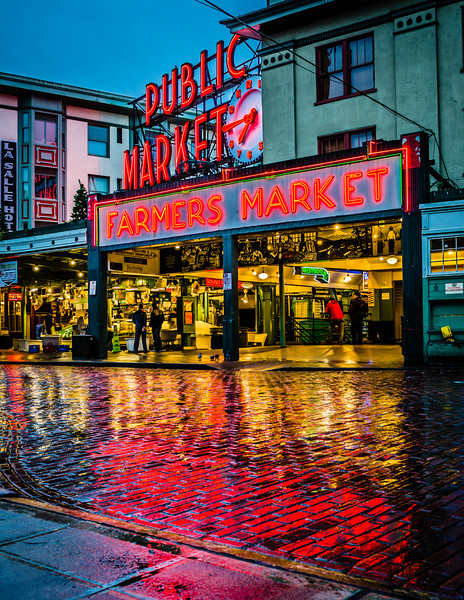 This is the Pike Place Market, in Seattle, during a beautiful drizzly morning. It's still early, the venders are setting up their stands, and there are no tourists; just a few locals chatting and watching the setup. Seattle is a beautiful place, even with the rain and especially here with the warm colors of the neon signs reflected on the wet cobblestone pavement.   Follow me on twitter | Facebook | Flickr | 500px | brian xavier prints