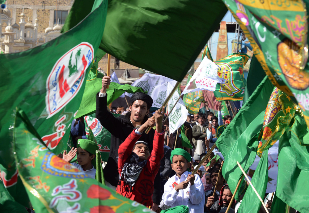 . Pakistani Muslims wave flags during celebrations marking Eid Milad-un-Nabi, the birthday of Prophet Mohammed, in Quetta on January 14, 2014. Muslims across the world celebrated the birth of the Prophet Mohammed on 12 Rabil ul Awal, a month of the Muslim calendar. (BANARAS KHAN/AFP/Getty Images)